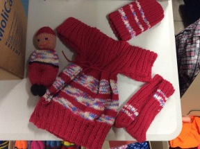 hand knitted tops, hat & mittens with a matching doll