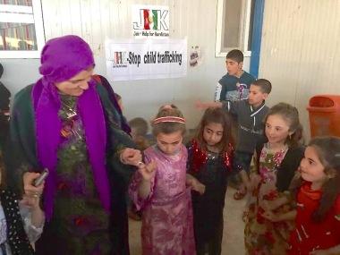 Dr Nemam with children at Bajed Kandala Camp